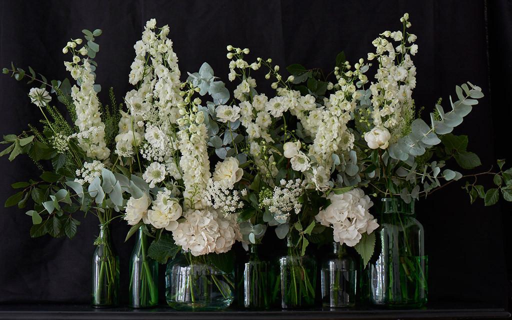 bridebook.co.uk pale flowers in glass vases