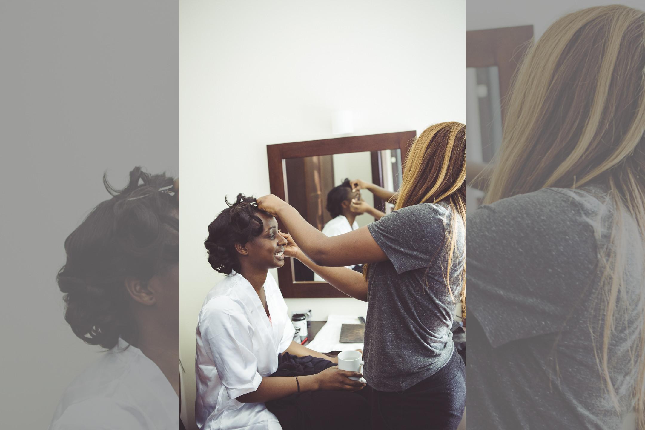 Bridebook.co.uk bride getting her makeup done
