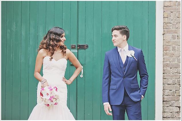 Bridebook.co.uk bride and groom in front of door