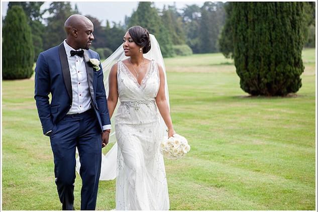 Bridebook.co.uk bride and groom walking hand in hand