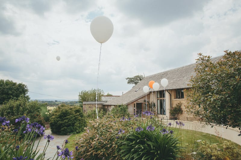 South West | Devon | Hittisleigh | Spring | Boho | DIY | Outdoor | White | Orange | Barn | Real Wedding | Helen Lisk Photography #Bridebook #RealWedding #WeddingIdeas Bridebook.co.uk