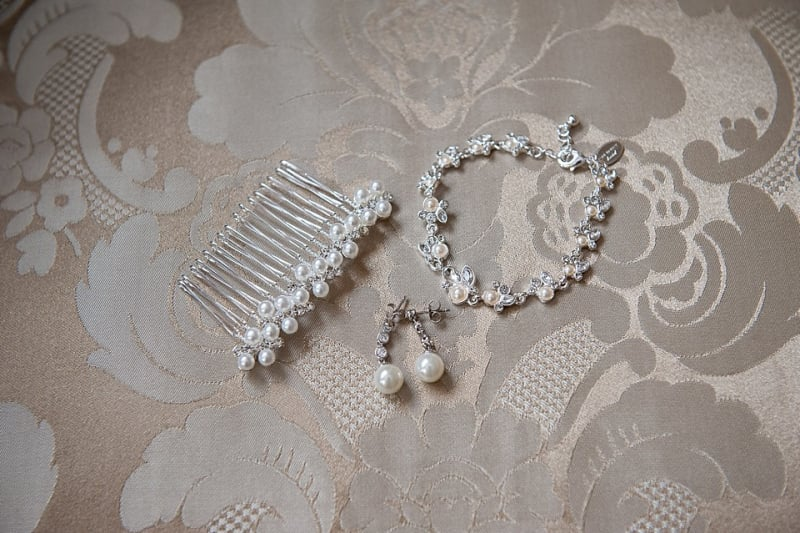 Bridebook.co.uk- bridal accessories hairpin earrings and bracelet laid out