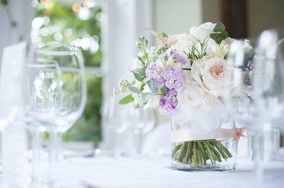 Bridebook.co.uk- pastel bridal bouquet as a table centerpiece
