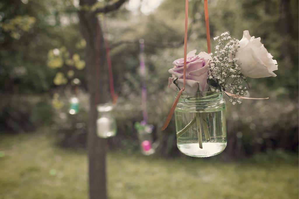 Bridebook.co.uk- two roses hung up in a jam jar