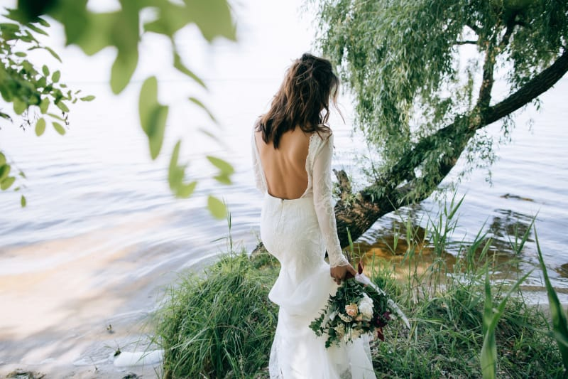 Bridebook.co.uk boho bride in backless flowing white dress