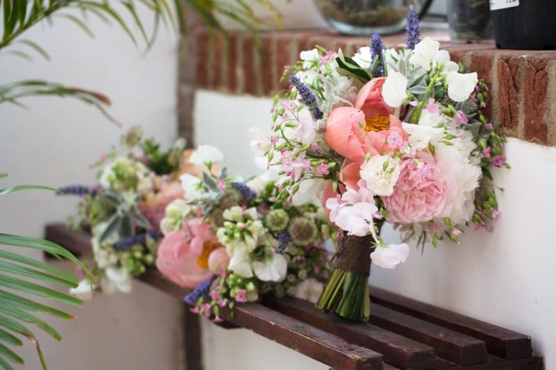 Bridebook.co.uk- wedding bouquets on a bench