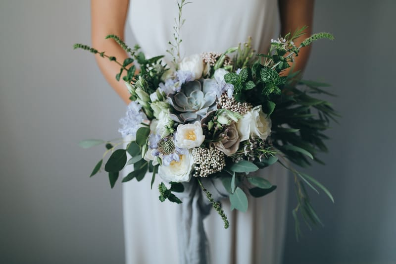 Bridebook.co.uk muted wedding bouquet with pale flowers and greenery