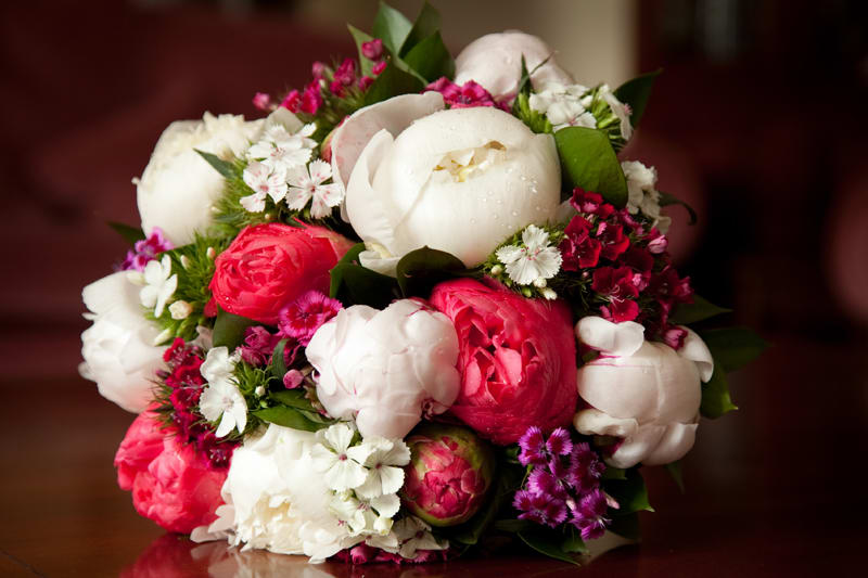 www.bridebook.co.uk red and white bridal bouquet with peonies