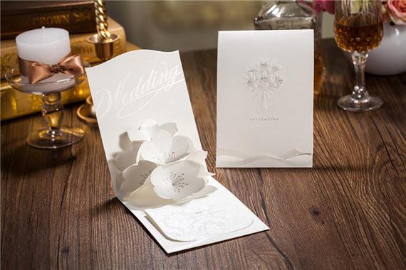 Bridebook.co.uk- three dimensional wedding invitation in white