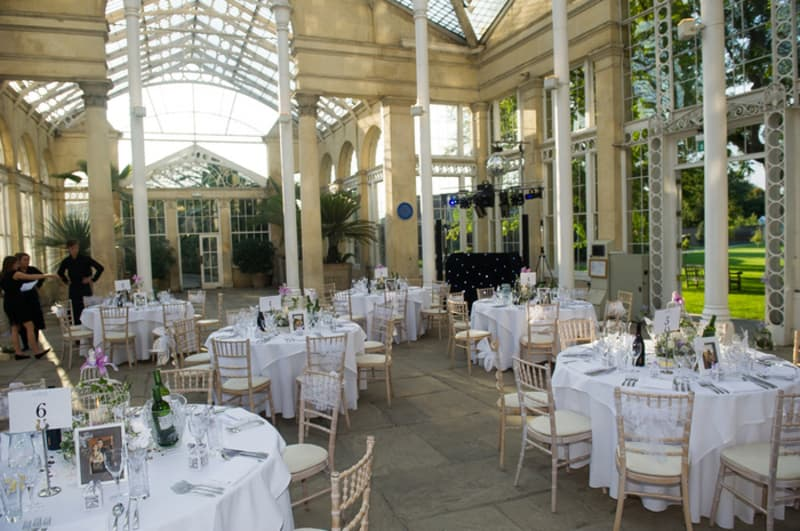 Bridebook.co.uk- wedding venue set up for reception with skylight roof