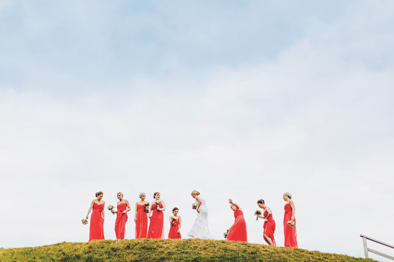 Bridebook.co.uk- bride and bridesmaids on a hill