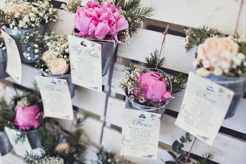 Bridebook.co.uk- seating plan with pots of flowers