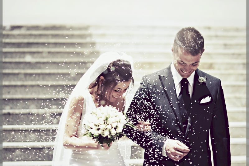 bridebook.co.uk couple showered with rice
