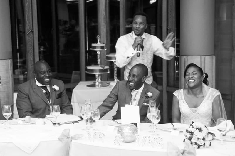 Bridebook.co.uk- best man doing his speech as groom and bride laugh