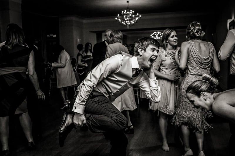 Bridebook.co.uk- best man having fun dancing