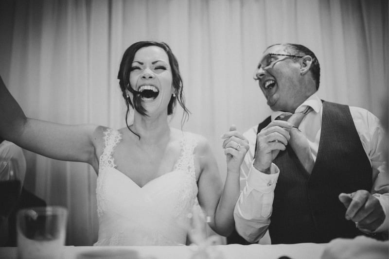 Bridebook.co.uk- bride laughing during speeches