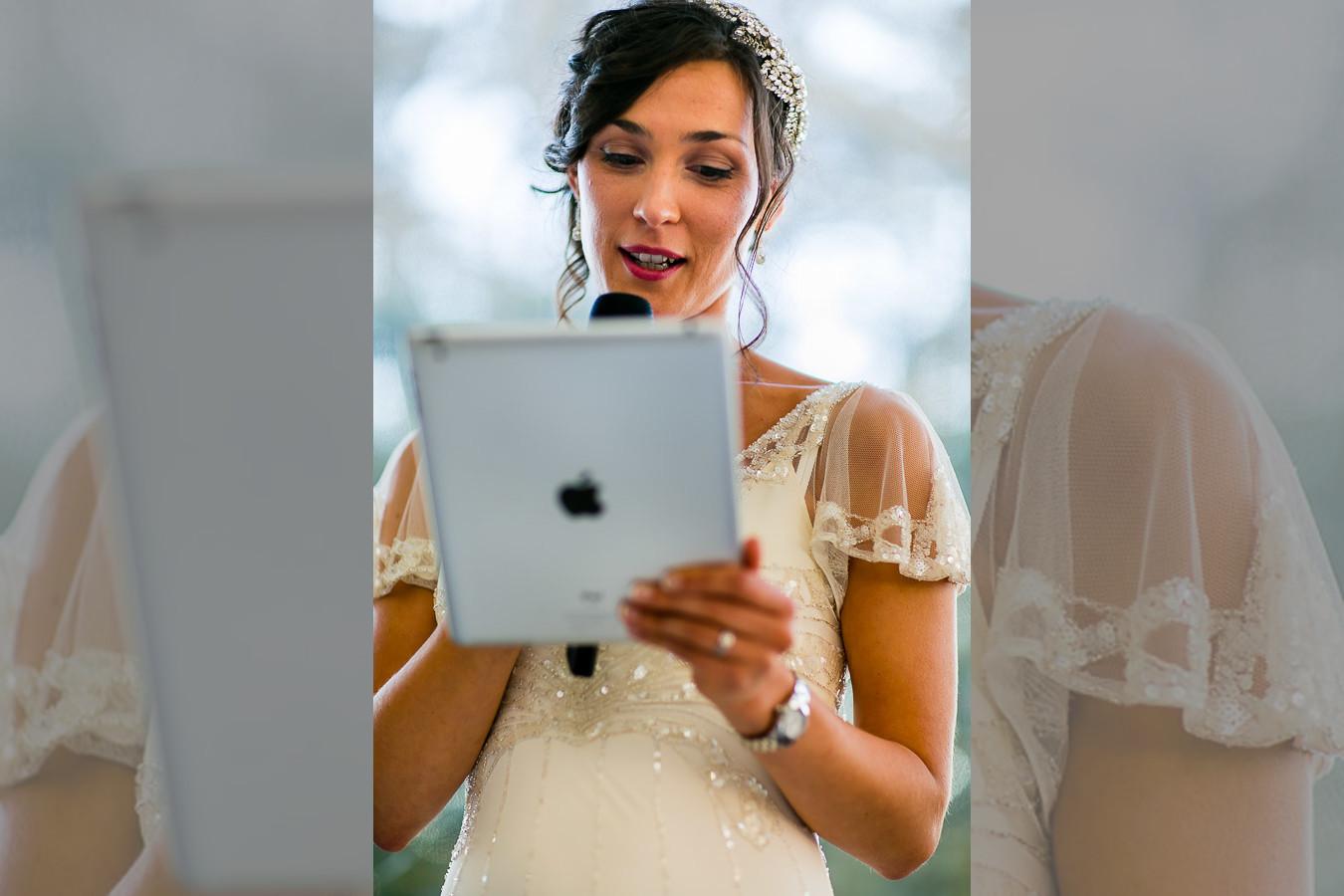 Bridebook.co.uk- bride reading her speech from ipad