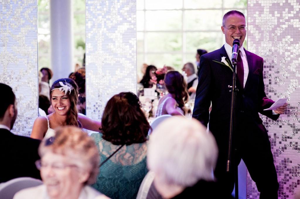 Bridebook.co.uk- father giving speech as bride smiles