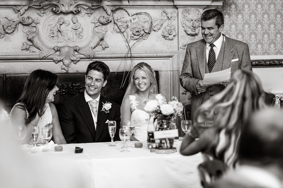 Bridebook.co.uk- father giving speech as groom bride and mother laugh