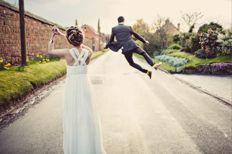 Bridebook.co.uk- groom skipping and bride clapping