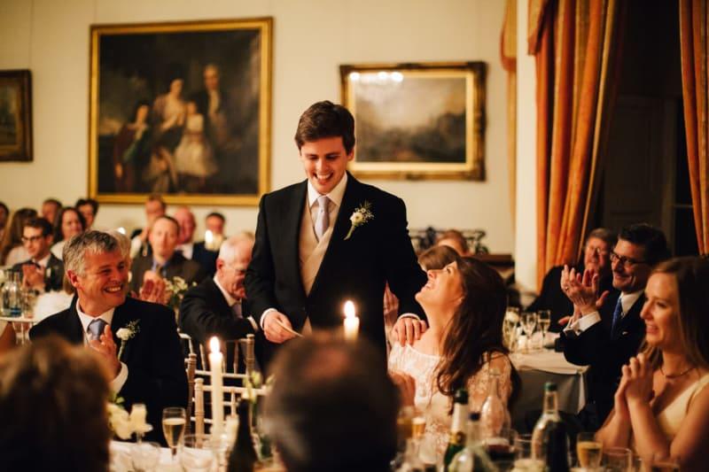 Bridebook.co.uk- groom giving his speech bride looking up to him