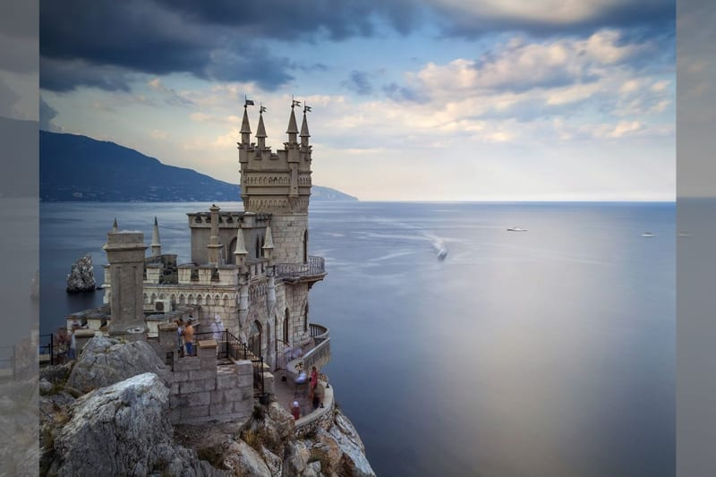 Bridebook.co.uk- castle standing on a cliff by the sea