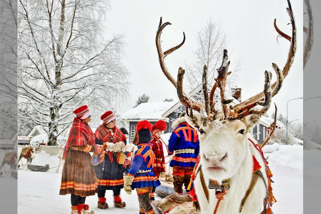 Bridebook.co.uk- reindeer sleigh and people in traditional costume