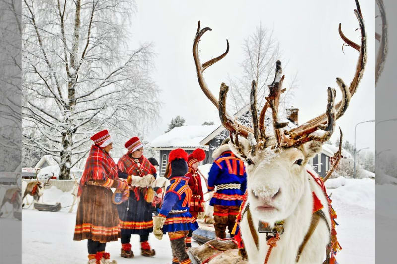 Bridebook.co.uk- reindeer sleigh and people in traditional costume