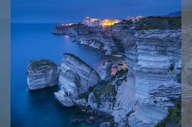 Bridebook.co.uk- seaside town on a cliff at night