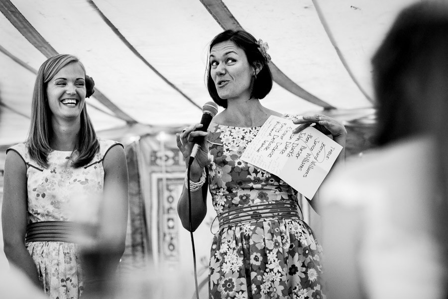 Bridebook.co.uk- maid of honour holding sheet and giving speech