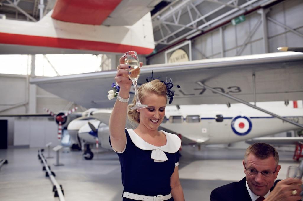 Bridebook.co.uk- maid of honour raising her glass after speech