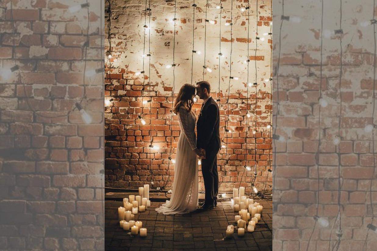bridebook.co.uk bride and groom in an industrial wedding venue