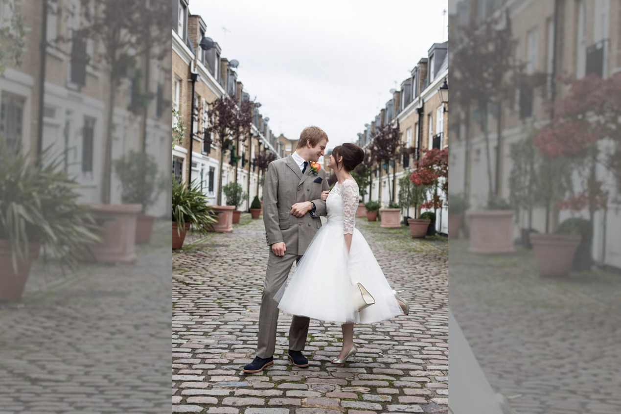 bridebook.co.uk London bride and groom with bride in a short wedding dress