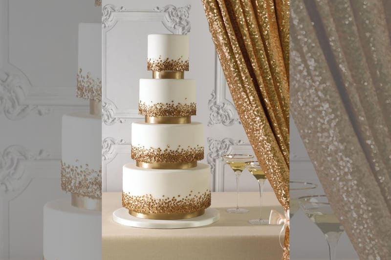 bridebook.co.uk gold accented wedding cake and decor
