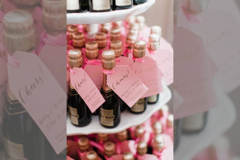 bridebook.co.uk mini pink champagne bottles as wedding  favours