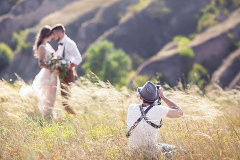 Bridebook.co.uk Wedding videographer in field