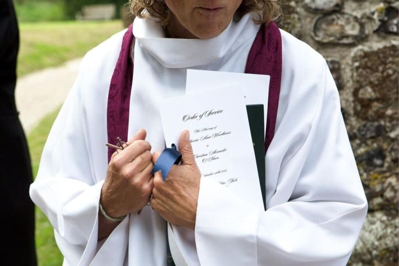Bridebook.co.uk- vicar standing with order of service