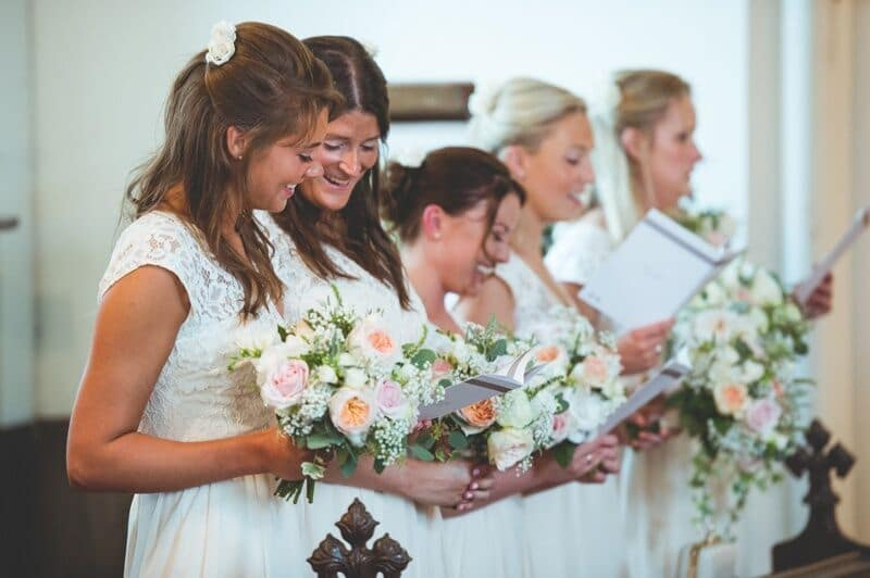 Bridebook.co.uk- bridesmaids reading from the order of service
