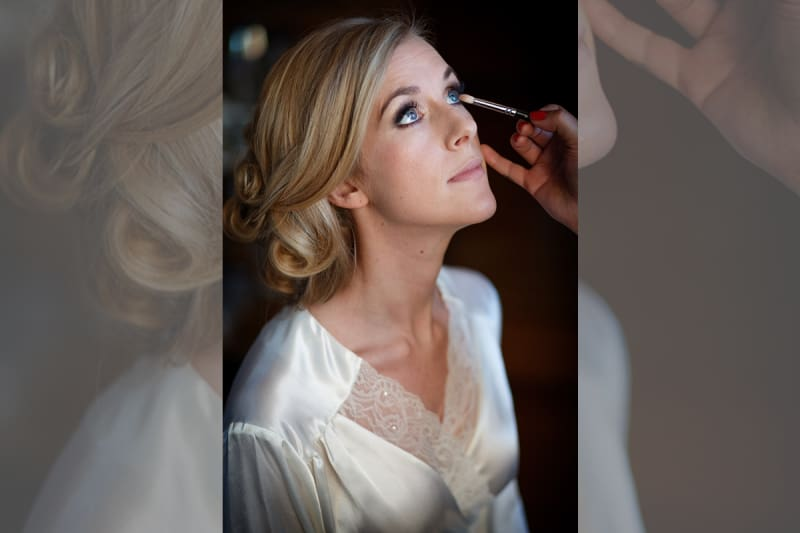 Bridebook.co.uk- bride having her make up done by artist