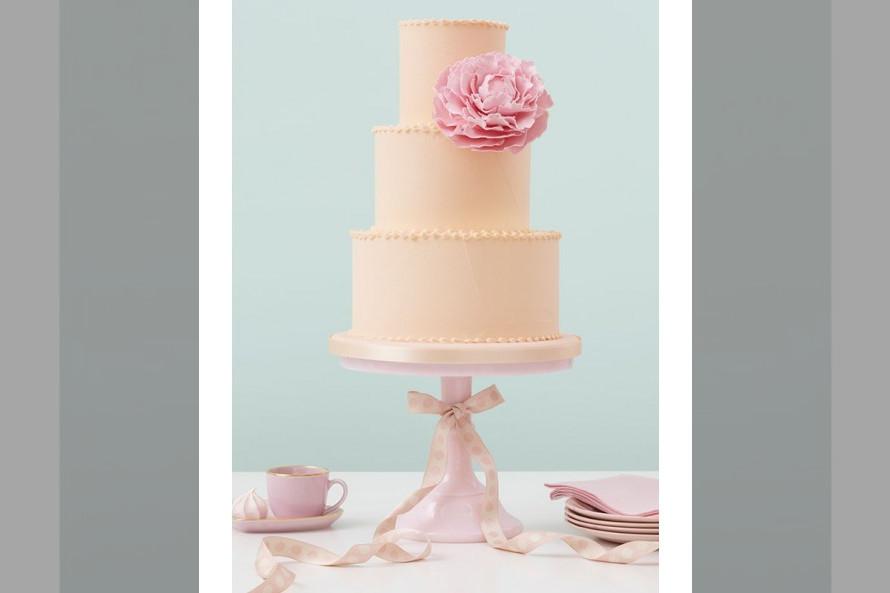 Bridebook.co.uk- peggy porschen three tier cake with pink flower decoration