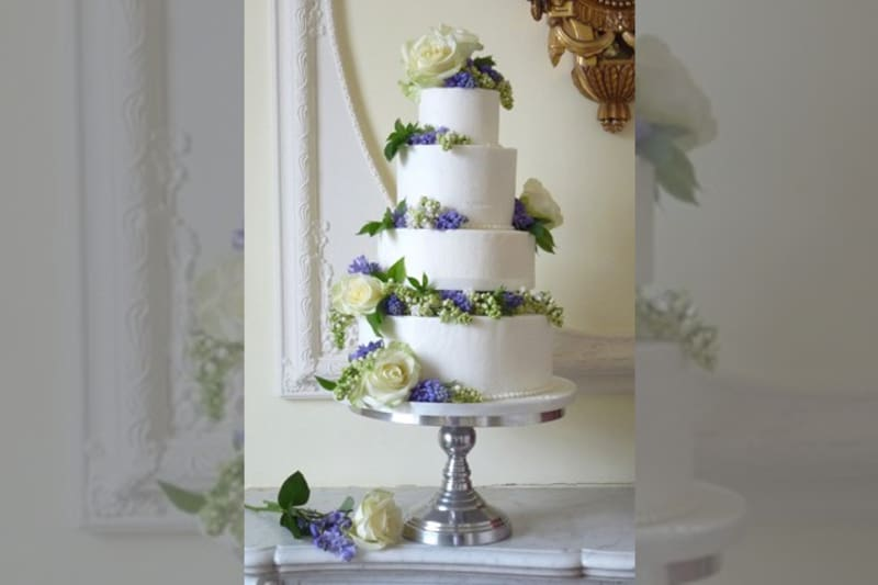 Bridebook.co.uk- four tier white cake decorated with real flowers