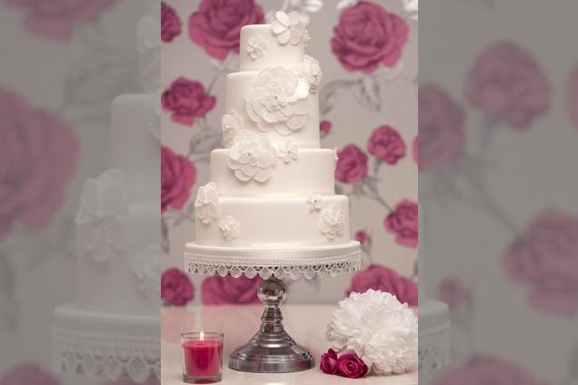 Bridebook.co.uk- white four tier wedding cake with sugar flowers