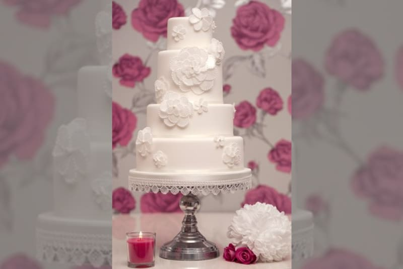 Bridebook.co.uk- white four tier wedding cake with sugar flowers