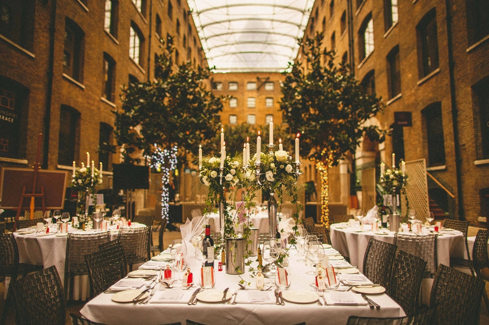 Bridebook.co.uk- wedding venue and tables decorated for the reception with candles