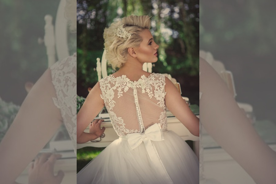 Bridebook.co.uk- bridal gown with sheer back and bow