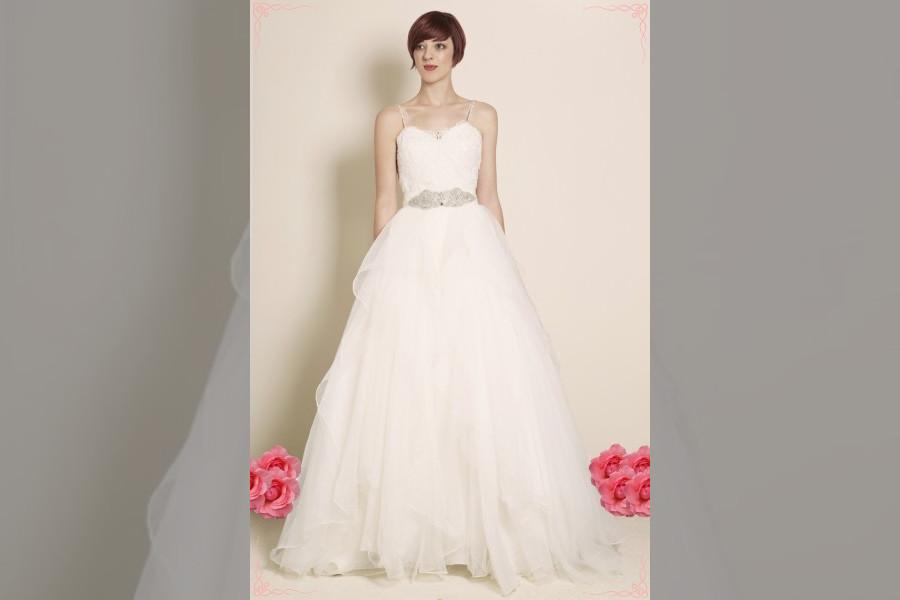 Bridebook.co.uk- model wearing bridal gown with belt detail