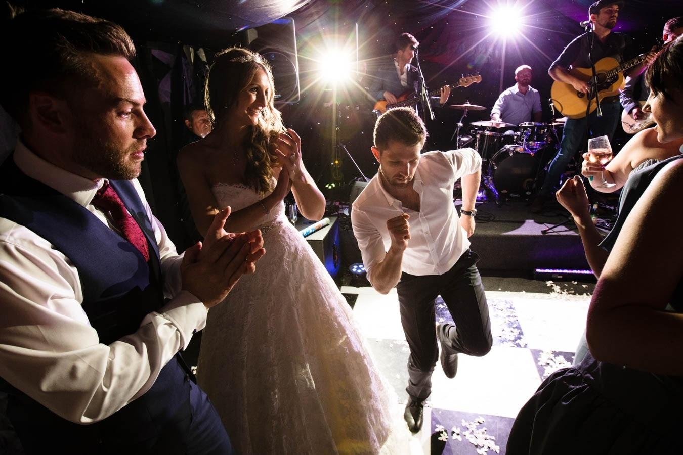 Bridebook.co.uk - bride and groom dancing with guests