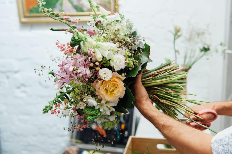 Bridebook.co.uk florist making up wedding bouquet