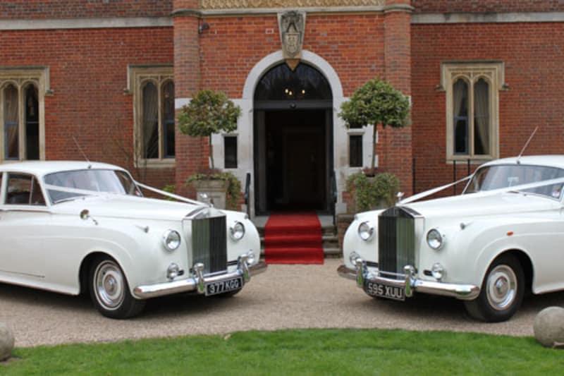 Bridebook.co.uk- two white rolls royce