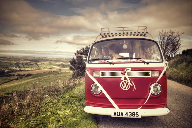 Bridebook.co.uk- bride and groom in red vw wagon